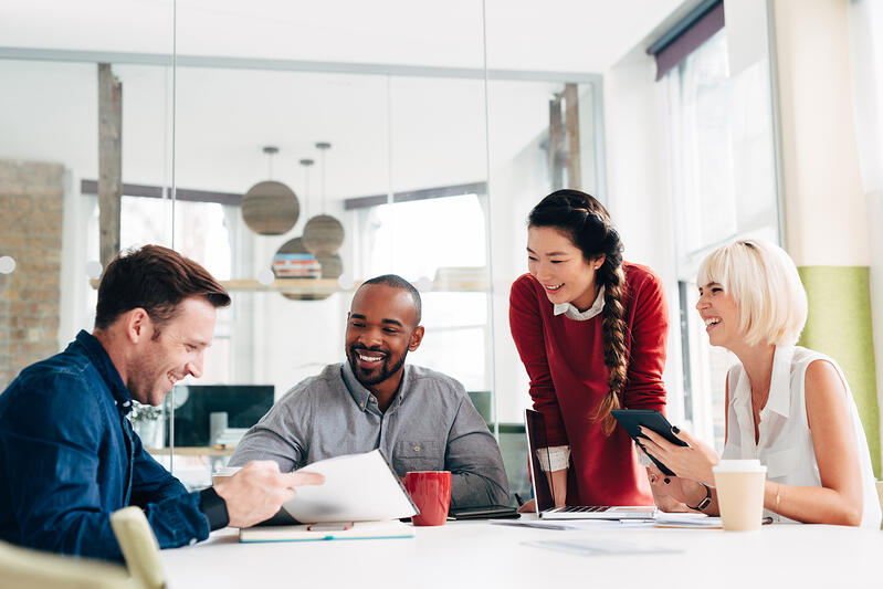 employees-collaborating-at-work-millennial-employment