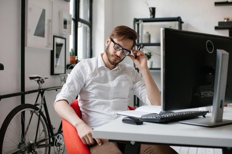 businessman-sitting-at-computer-delegation