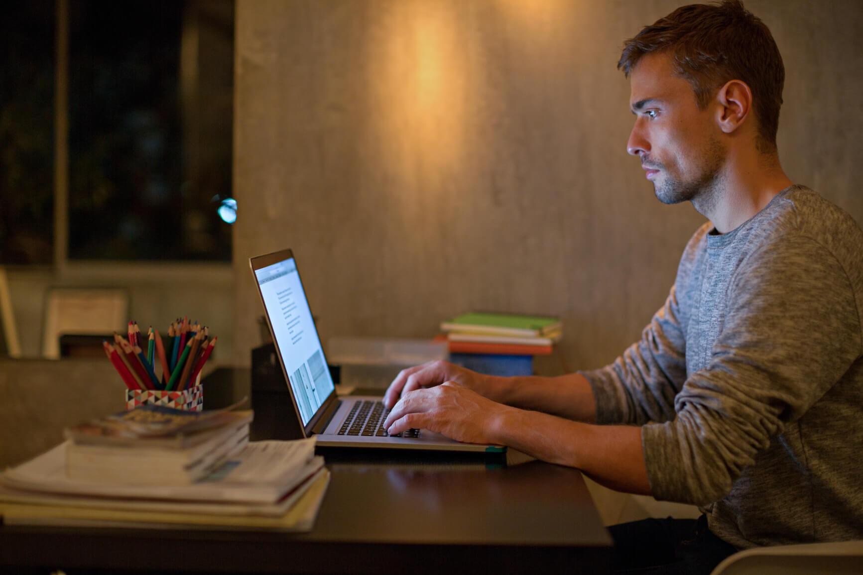 man-working-on-computer-gaslighting-at-work