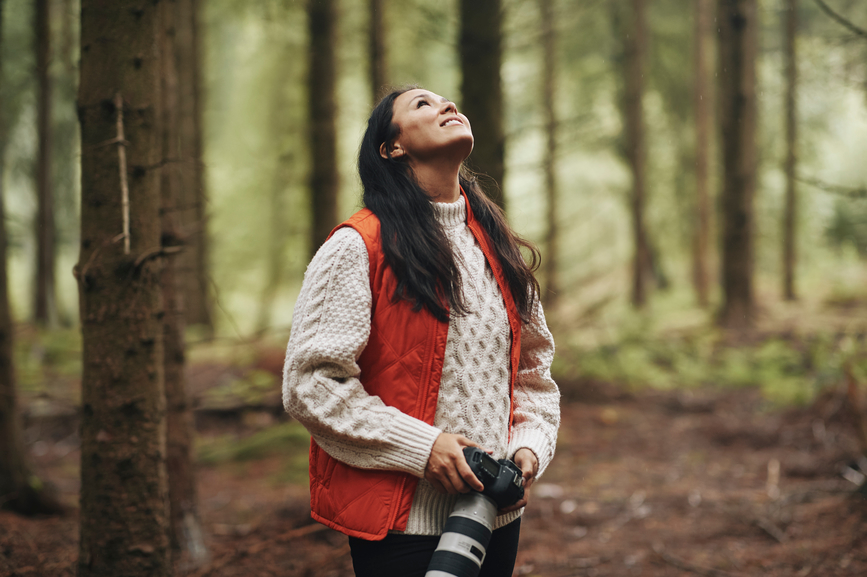 woman-taking-leisurely-walk-in-woods-manage-your-energy-not-your-time