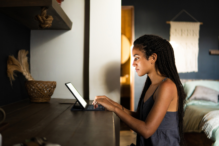 woman-working-late-at-laptop-manage-your-energy-not-your-time