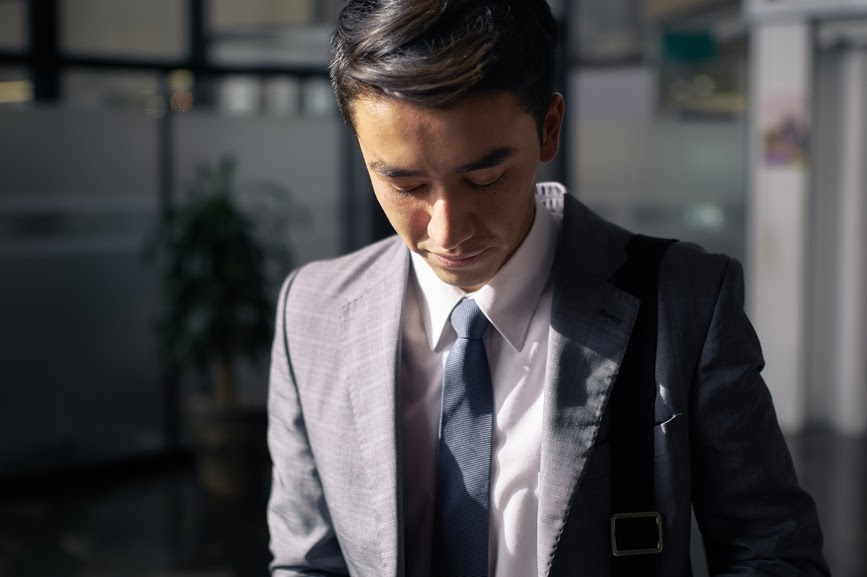 male-employee-looking-down-stress-management-at-work