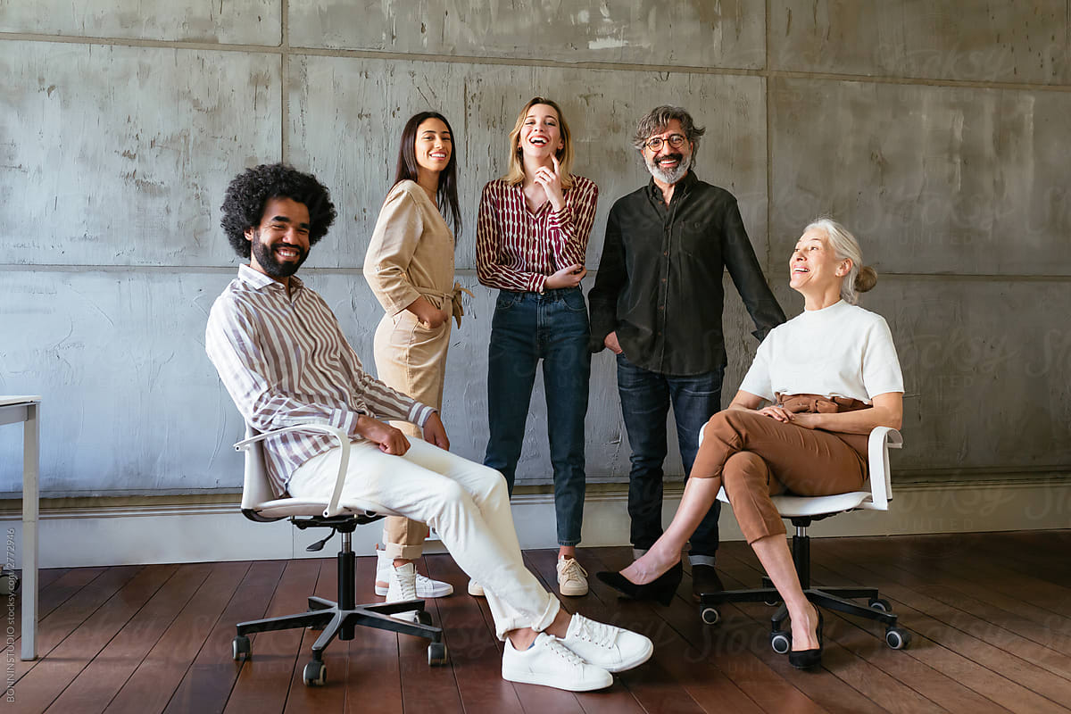 group-of-five-people-smiling-at-work-growth-mindset