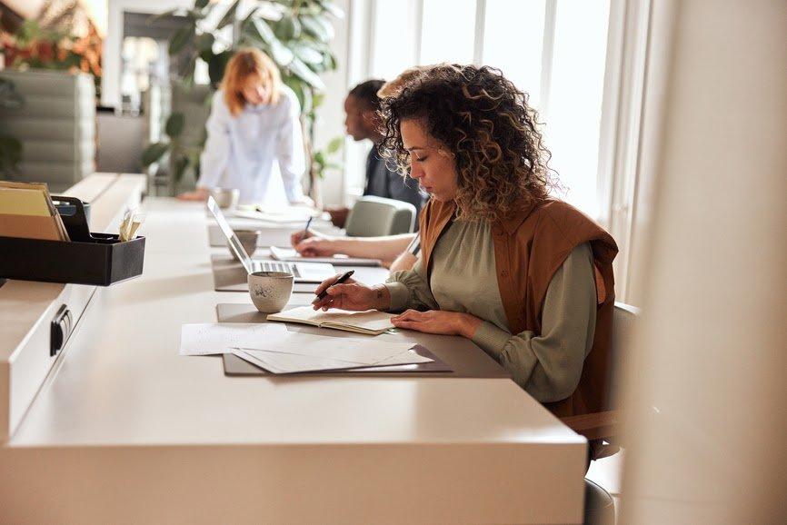 businessowoman-going-over-paperwork-in-an-office-human-resource-reporting