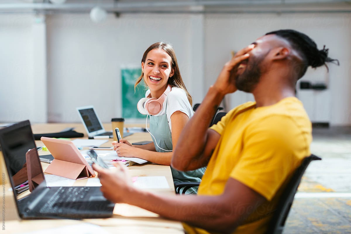 employees-having-a-laugh-while-working-intellectual-curiosity
