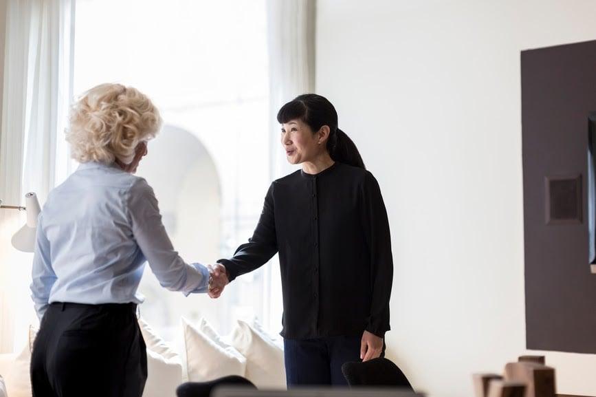 two-employees-shaking-hands-mentor-vs-sponsor