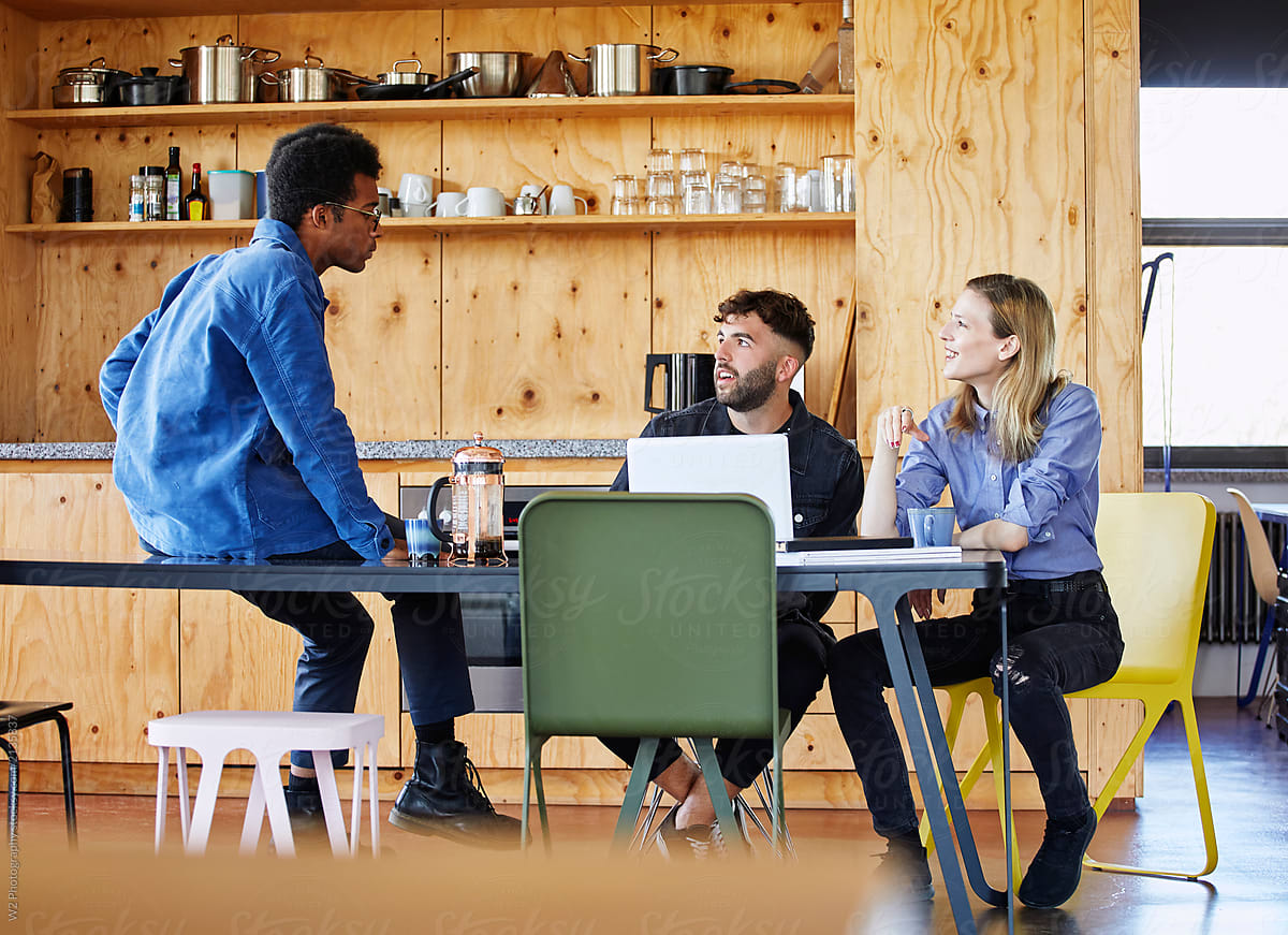 image-diverse-employees-discussing-sitting-around-a-table-employee-resource-group