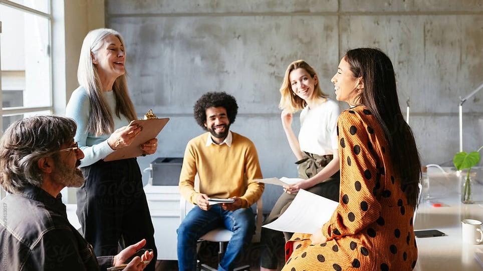 employee resource group - image-employees-happily-chatting-in-an-office-employee-resource-group-1-1