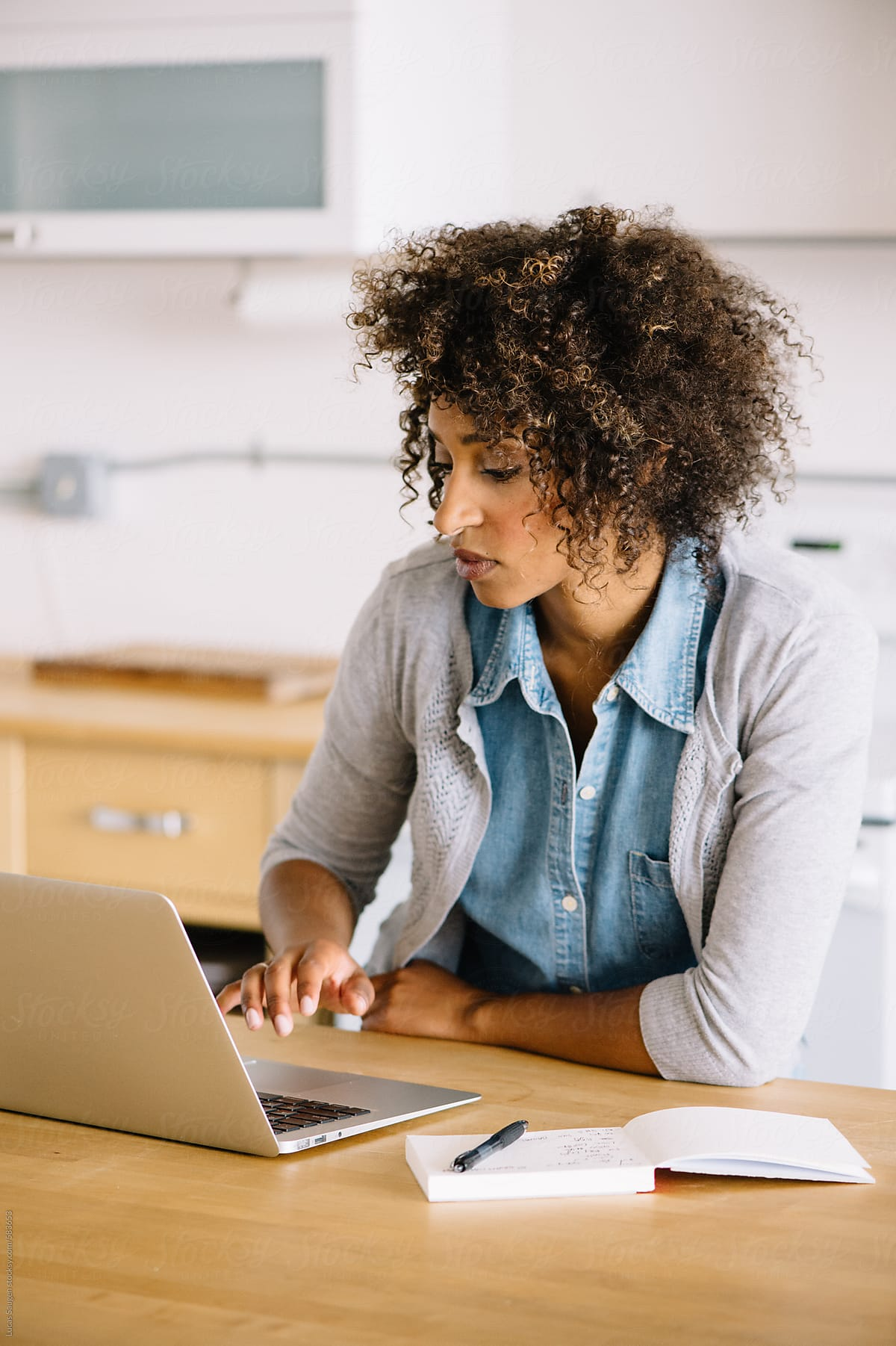 mage-woman-using-laptop-with-notebook-beside-her-employee-retention