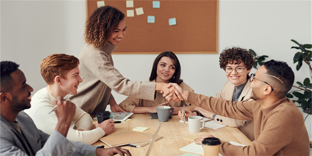 group-of-six-people interact-around-table-team-conflict