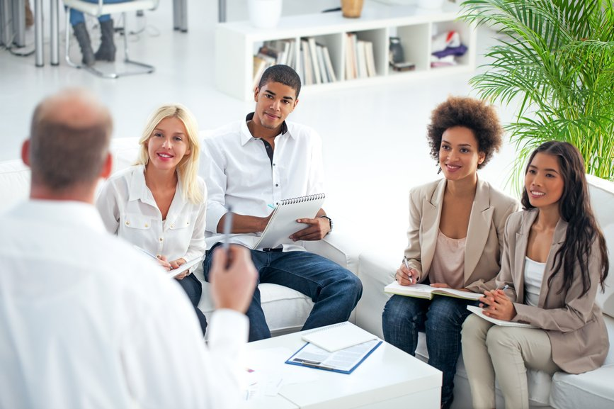male-leader-discussing-with-employees-in-a-meeting-values-of-a-leader