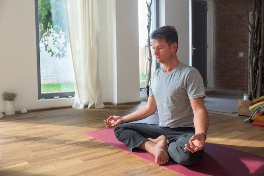 man-meditating-in-lotus-pose-mental-fitness
