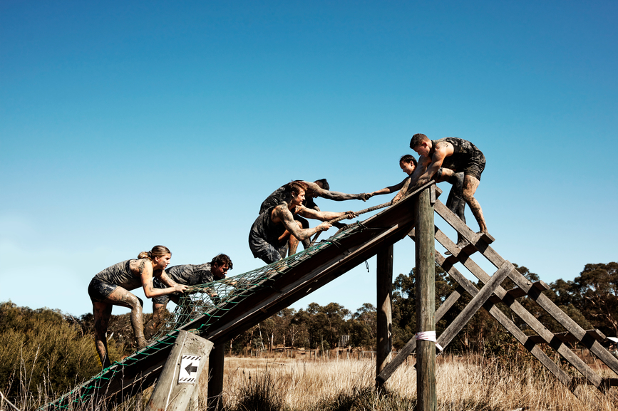 team-mates-helping-each-other-in-obstacle-course-team-conflict