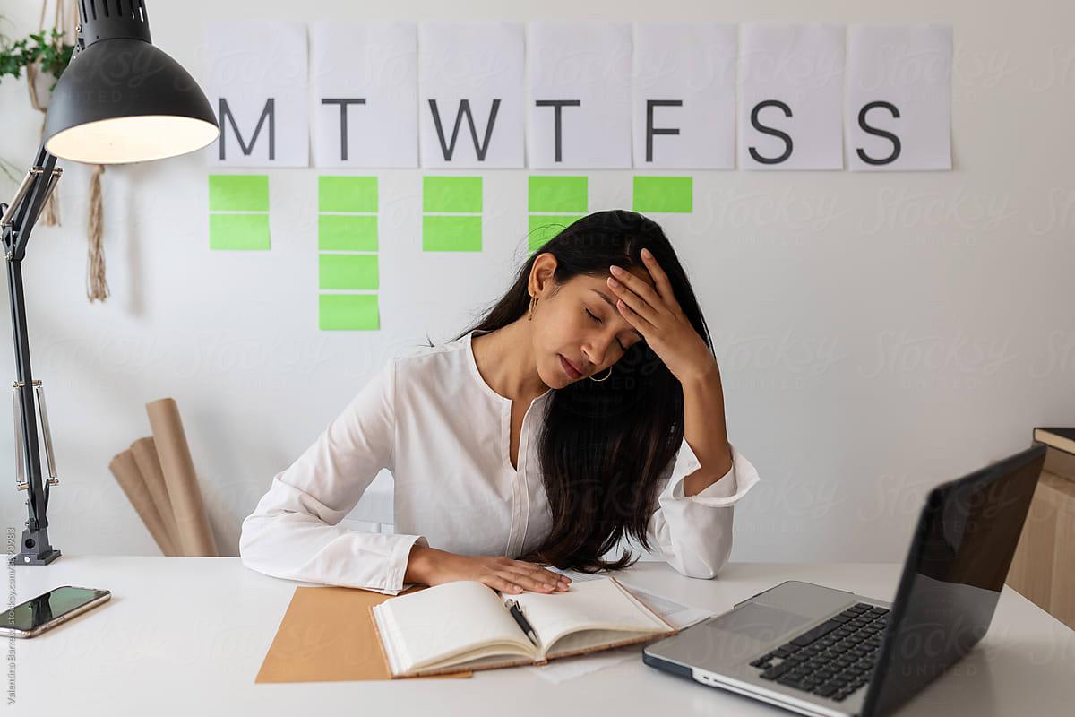 tired-employee-at-desk-always-working-hard