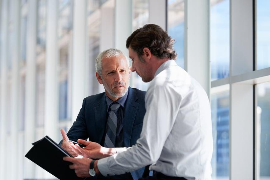 two-businessmen-negotiate-team-conflict