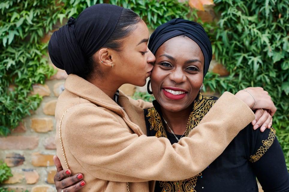 woman-kissing-mother-on-cheek-emotional-health