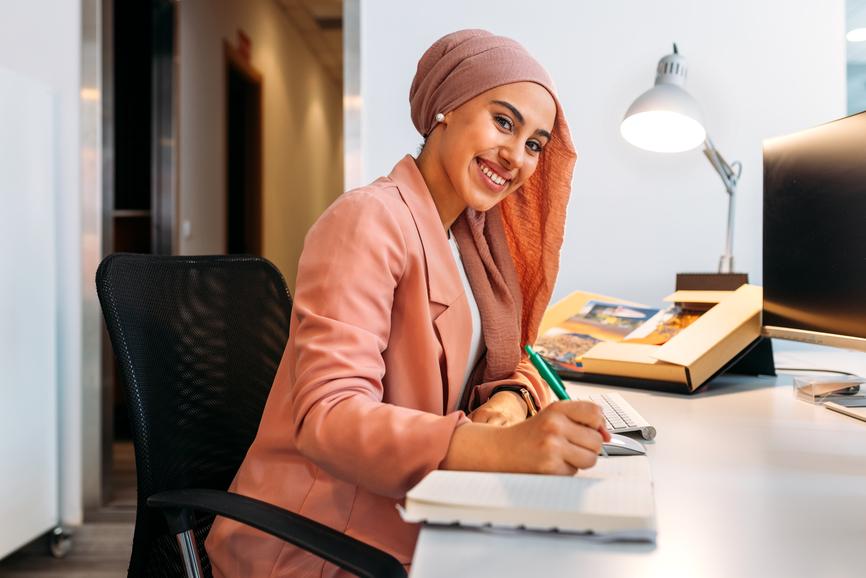 young-woman-writing-at-desk-employee-development