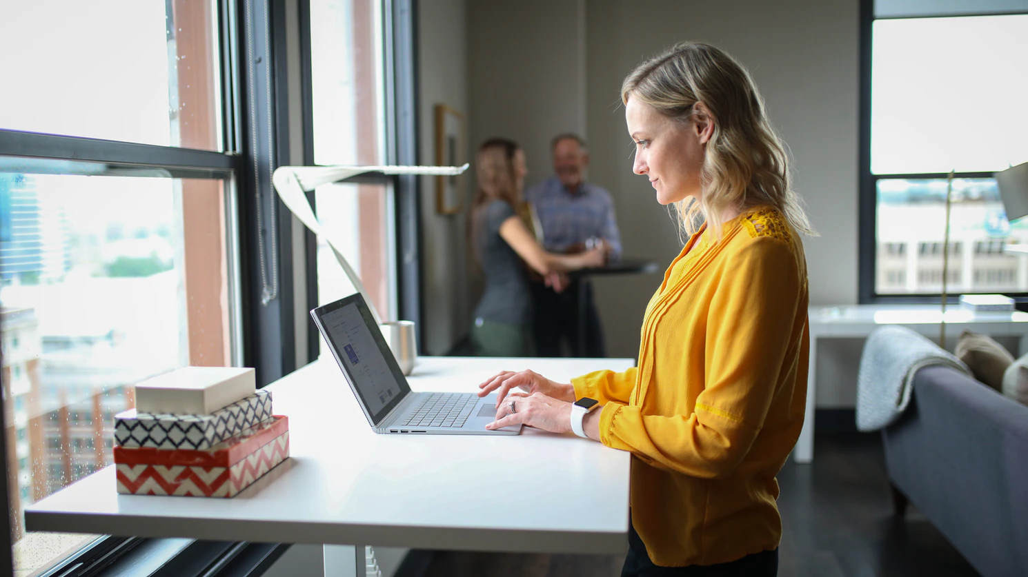 woman-working-at-standing-desk-health-at-work