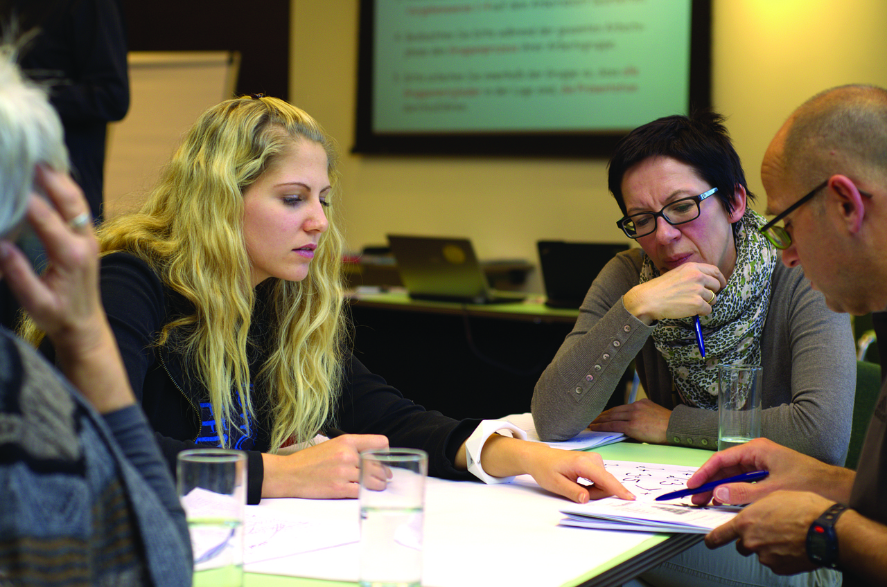 group-learning-together-at-work-upskilling