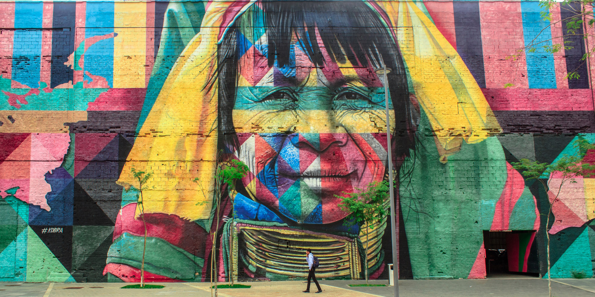 Street art image of a person painted with many colors
