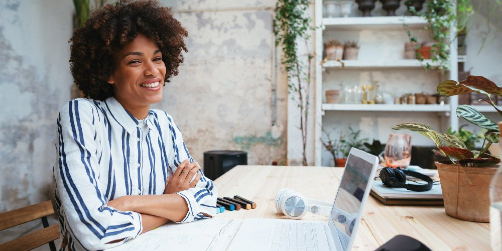 woman with arms crossed and confident smile -empowerment-at-work
