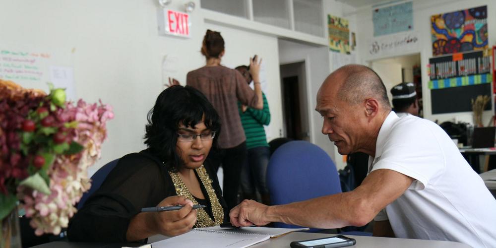 man-mentoring-a-woman-at-work