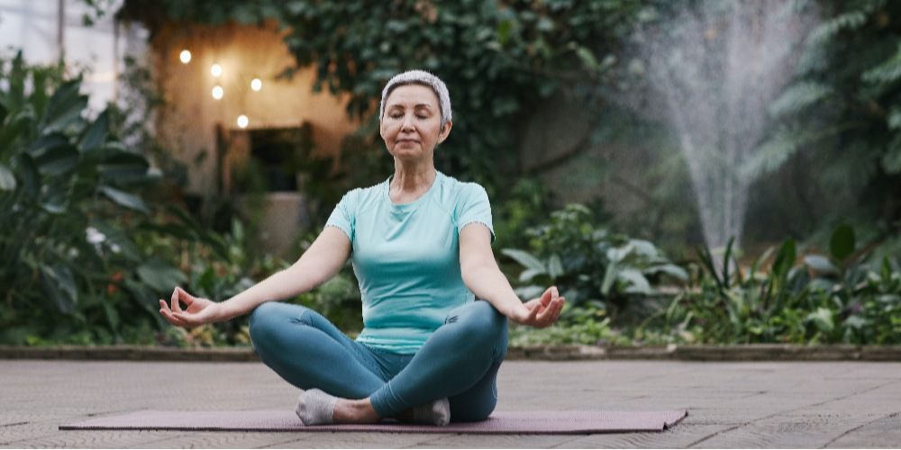 woman-meditating-improve-employee-well-being-for-better-performance