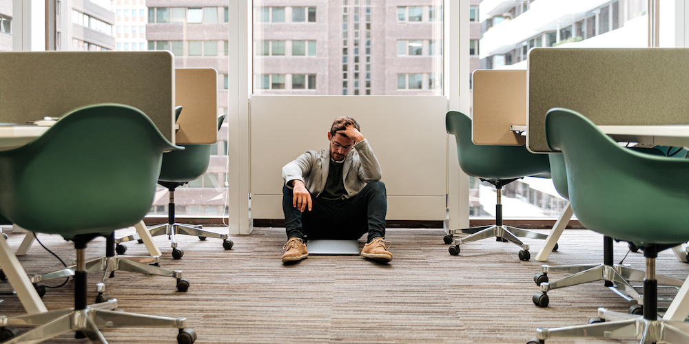 A man feeling fear and anxiety at work