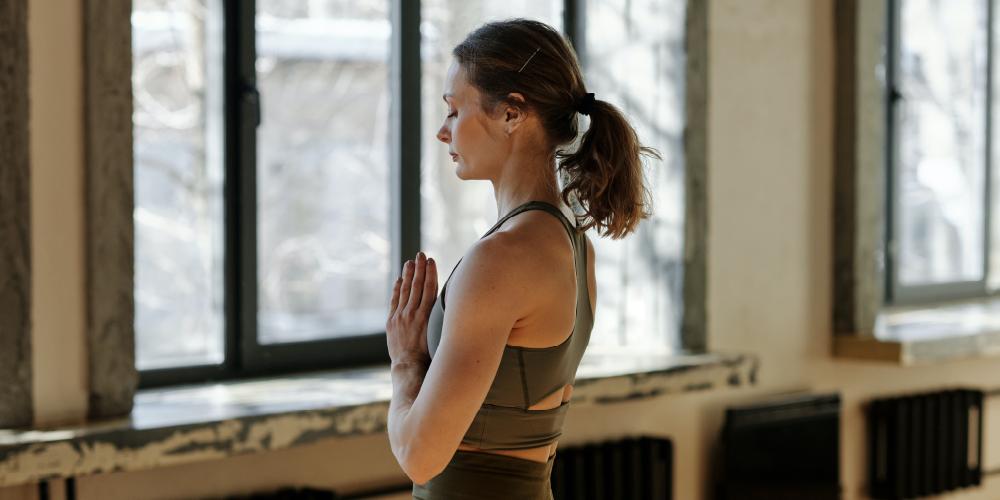 woman in a praying yoga pose