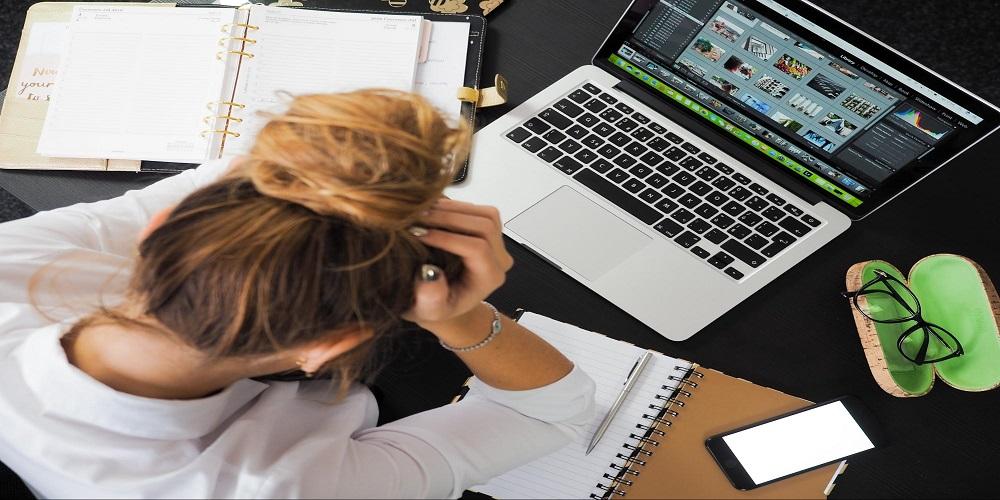 woman worrying at computer
