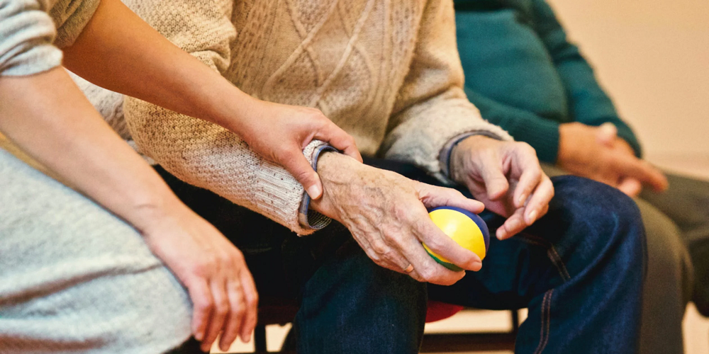 elderly-holding-a-rubber-ball-what-is-compassion